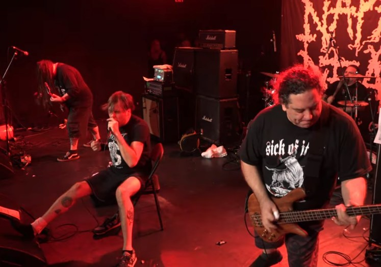 NAPALM DEATH's Mark 'Barney' Greenway injures right ankle, performs sitting down